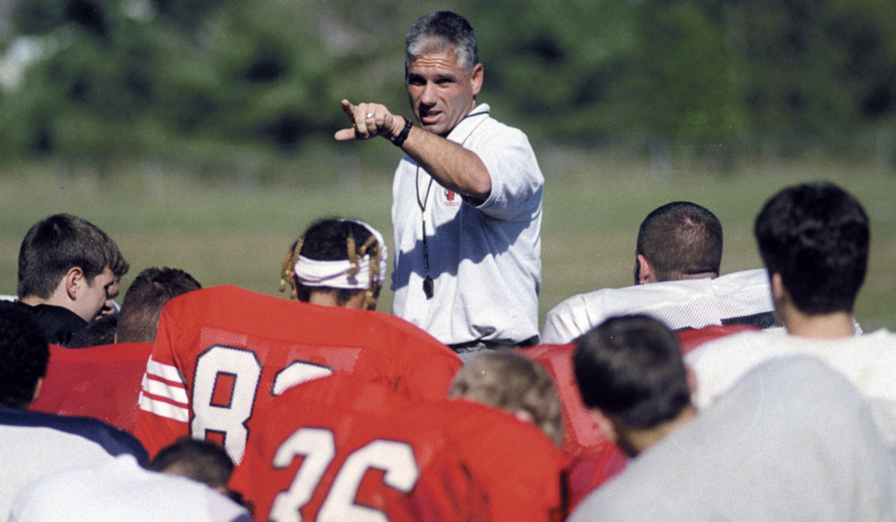 Staff file photo by Andy Molloy   Cony football coach Tom Hinds addresses the players during practice on Sept. 13, 2000.