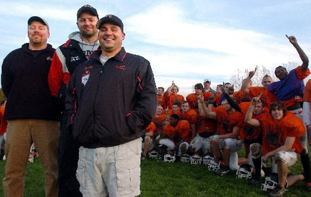 Staff file photo by Andy Molloy   Gardiner Area High School football coach Matt Brown, middle, poses with assistants Mike Gammon, left, and Jim Palmer during the 2005 season.
