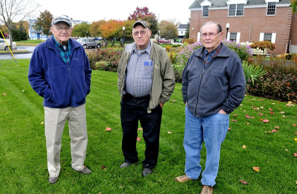 Local men who knew convicted killer and suspected serial killer Charles Terry when he resided in Waterville and neighboring towns as a young man are, from left, John McQuillan, his brother Robert and Lowell Hawes. The men are standing on the lawn of Kennebec Savings Bank, where the house at 95 Pleasant St. once stood. Terry lived there for the first 10 years of his life before moving to Winslow in 1941.