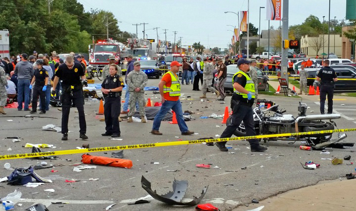 The Associated Press/ David Bitton/The News Press Emergency personnel respond to the scene of an accident after a vehicle crashed into a crowd of spectators during the Oklahoma State University homecoming parade, causing multiple injuries, on Saturday in Stillwater, Oka.