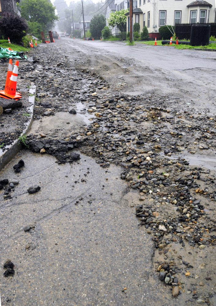 Patterson Street in Augusta, shown here after a major rainstorm in August, is one of the streets that would be scheduled for repair if city residents approve a $1.7 million bond issue on the Nov. 3 ballot.