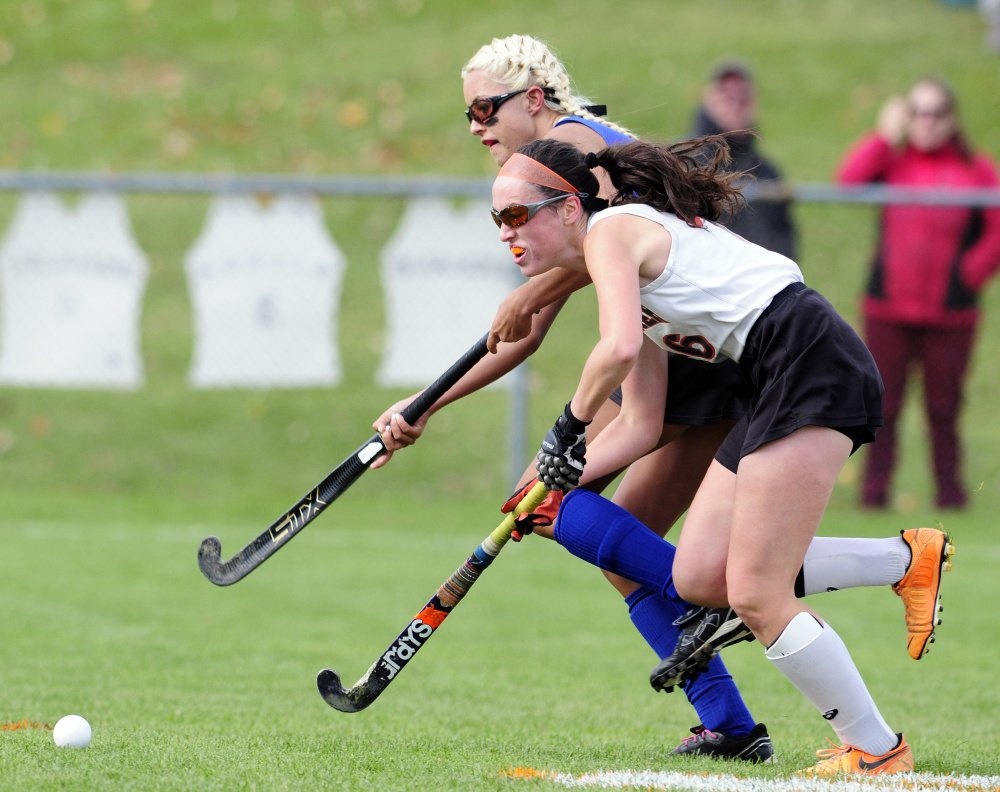 Staff photo by Joe Phelan   Lawrence forward Hallee Parlin, back, chases after ball with Gardiner midfielder Bryce Smith during a Class B North semifinal game Saturday afternoon in Gardiner.