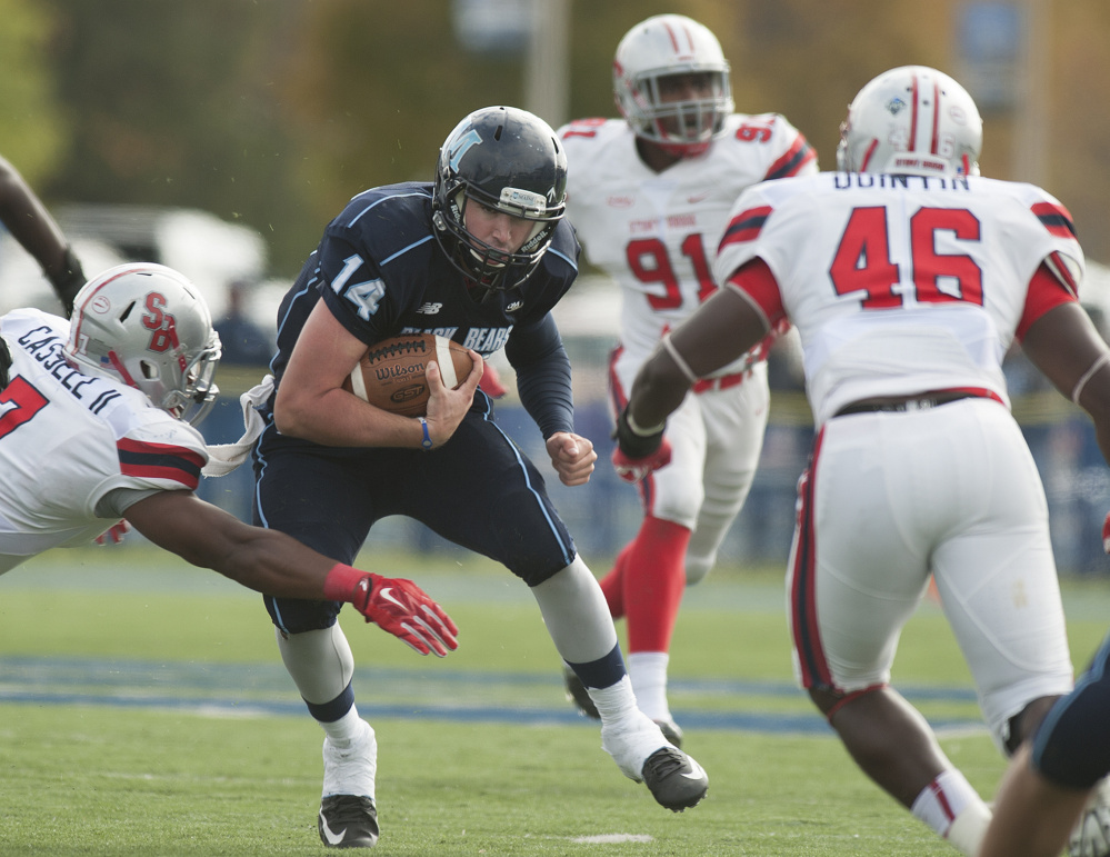 UMaine quarterback Drew Belcher weaves through the Stony Brook defense during Saturday's game in Orono. Belcher replaced starter Dan Collins in the first quarter and rushed for a touchdown in Maine's 23-10 win.