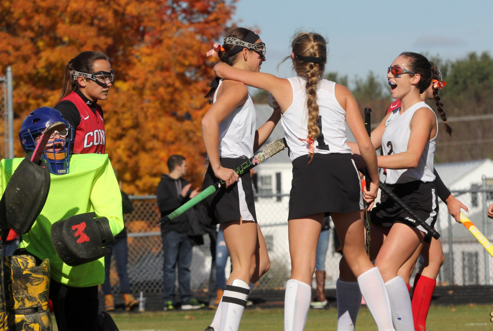 Photo by Jeff Pouland   Skowhegan Area High School's Brooke Michonski gets congratulated after scoring a first-half goal by teammates Julia Steeves (1) and Maliea Kelso (2) during a Class A North semifinal against Cony High School on Saturday in Skowhegan.