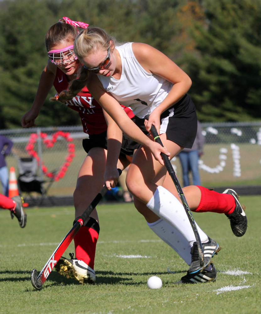 Photo by Jeff Pouland   Skowhegan Area High School's Julia Steeves battles for the ball with Cony High School's Julia Nicol during the first half of a Class A North seminfinal game on Saturday in Skowhegan.