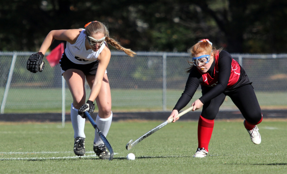 Photo by Jeff Pouland   Skowehegan's Elizabeth York and Cony's Cari Hopkins battle for the ball during the first half of a Class A North seminfinal Saturday in Skowhegan.