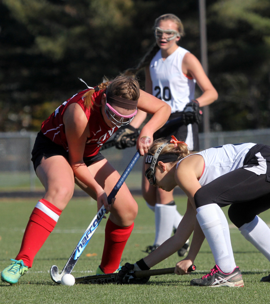 Photo by Jeff Pouland   Cony High School's Abigail Silsby tries to move the ball around Skowhegan's Rylie Mullen during the first half of a Class A North seminfinal game Saturday in Skowhegan.