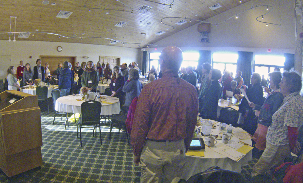 Participants stand as they sing together at the start of the Singing For Those at the End of Life conference Saturday at Maple Hill Farm Inn and Conference Center in Hallowell.