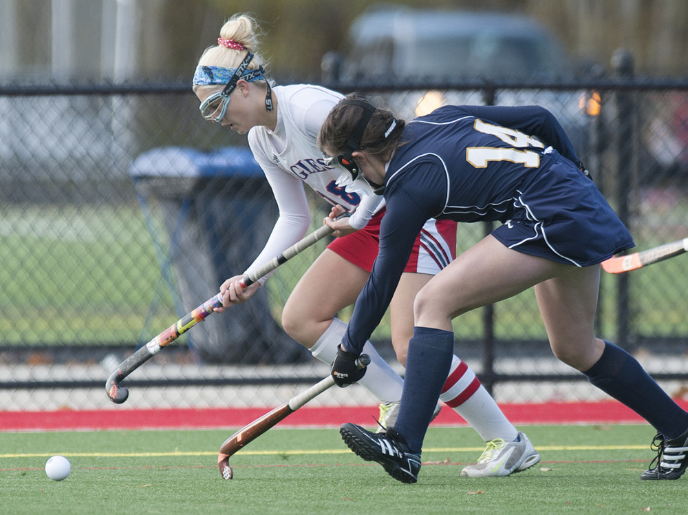 Kevin Bennett photo   Messalonskee's Nathalie St. Pierre, left, and Mt. Blue's Gracie Foss look to gain control of the ball during the first half Saturday.