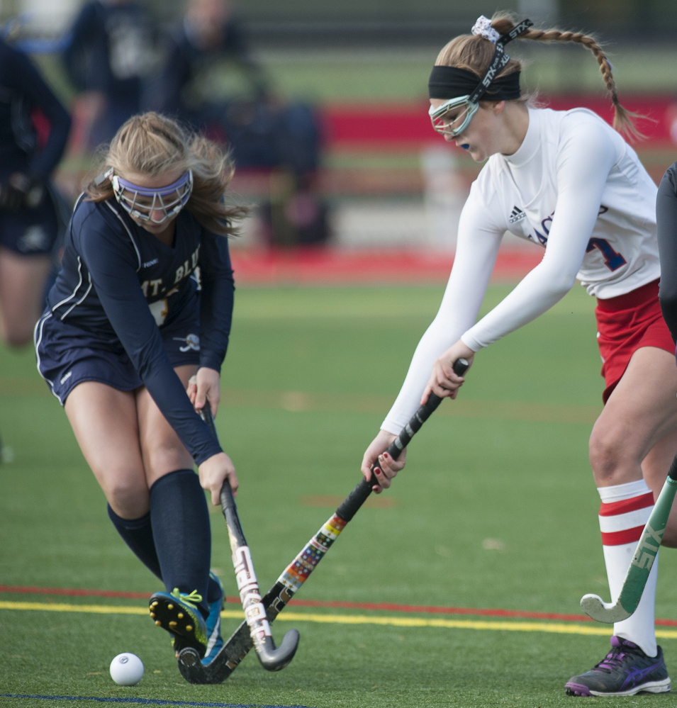 Kevin Bennett photo   Mt. Blue's Jordyn Lawrence, left, and Messalonskee's Emily Hogan compete for possession during a Class A North semifinal Saturday at Thomas College.