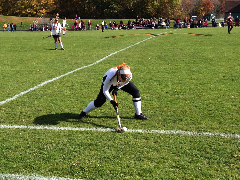 Staff photo by Evan Crawley   Winslow's Ciera Poulin looks to get the ball up the field during a Class B North semifinal game against Foxcroft on Saturday in Winslow.