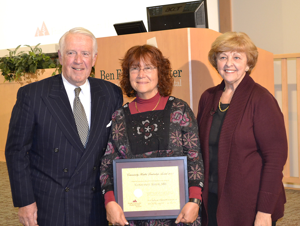 Dr. Connie Adler is presented with the Franklin Community Health Leadership Award. Pictured from left are Joseph Bujold, Adler and Rebecca Arsenault.