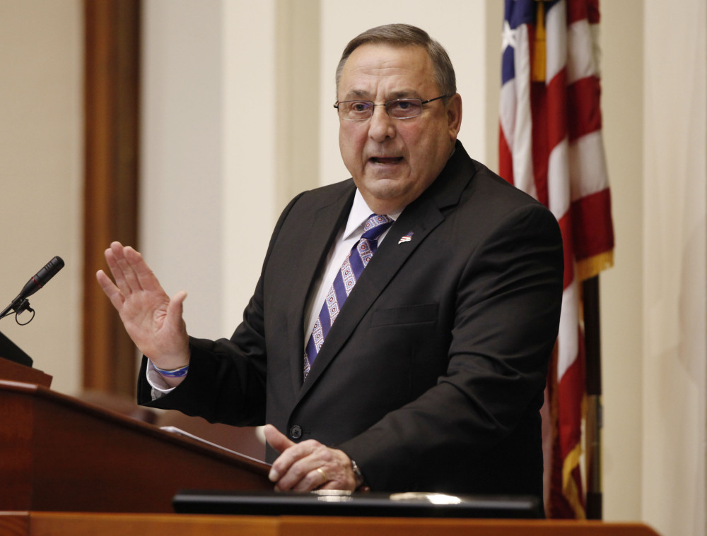 """In this Feb. 3 photo, Gov. Paul LePage delivers his State of the State address to the Legislature at the Statehouse in Augusta. LePage made a wisecrack at a town hall meeting in Auburn that fell flat with women across the state. A spokesman for Maine Gov. Paul LePage said he was clearly joking when he criticized the spending needed for a campaign finance reform referendum as being akin to """"giving your wife your checkbook."""" The governor's spokeswoman, Adrienne Bennett, pointed out that the governor's wife is in charge of LePage's checkbook."""