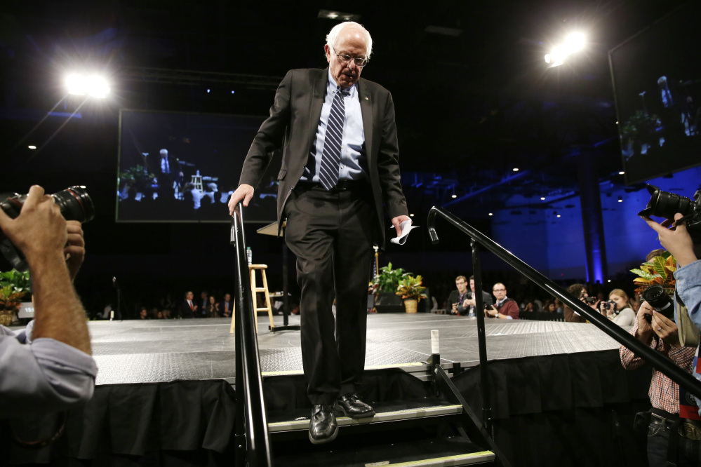 Democratic presidential candidate Sen. Bernie Sanders, I-Vt., walks off stage after speaking during the Iowa Democratic Party's Jefferson-Jackson fundraising dinner, Saturday in Des Moines, Iowa.
