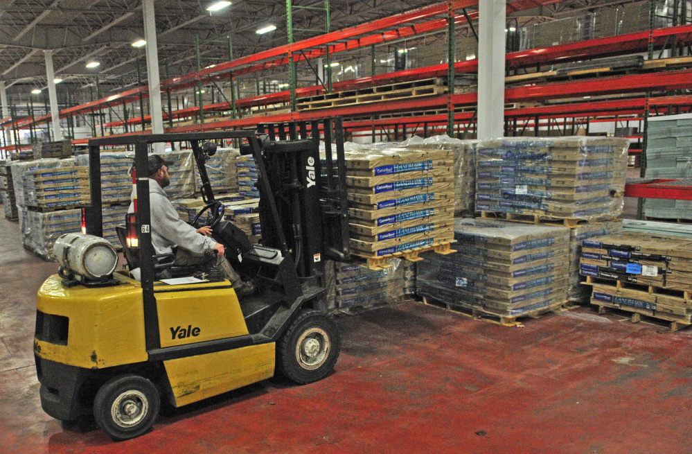 Warehouse manager Jake Dube picks up a load of shingles Thursday at the Harvey Building Products warehouse on Anthony Avenue in Augusta.