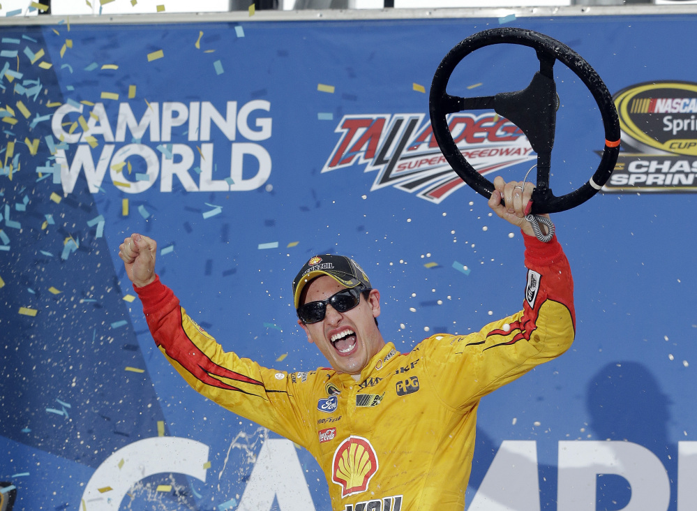 Joey Logano celebrates in Victory Lane after winning the Campingworld.com 500 on Sunday at Talladega Superspeedway in Talladega, Ala.