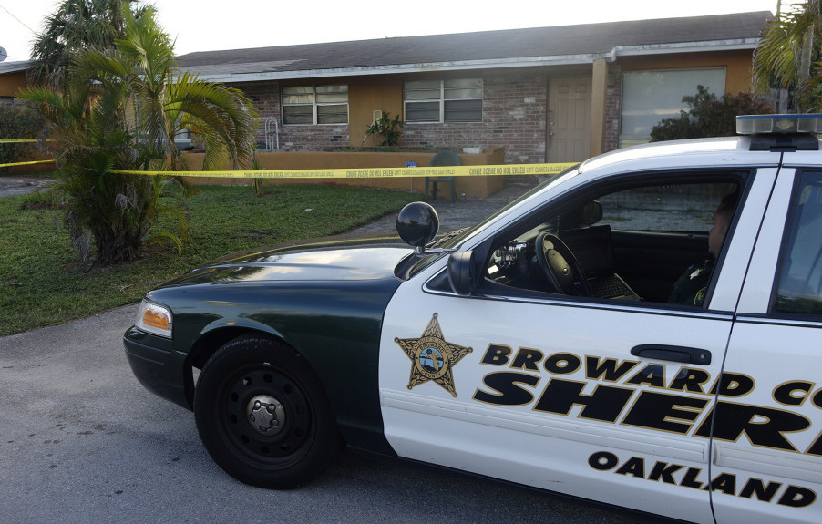 A Broward County, Florida patrol car is seen in Oakland Park on Wednesday outside the home of Charlotte Nicholas, a former Augusta woman who was found dead in her apartment by a neighbor.