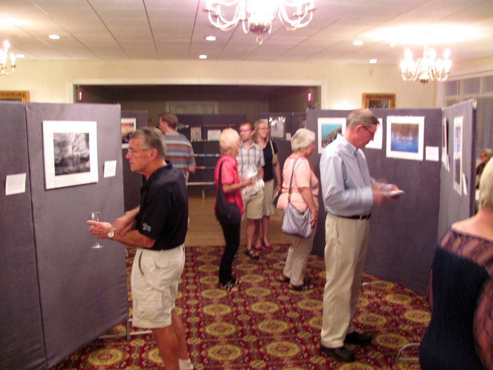 Photography enthusiasts viewed many works on display at the recent Western Mountain Photography Show, sponsored by the Rangeley Friends of the Arts at the historic Rangeley Inn and Tavern.