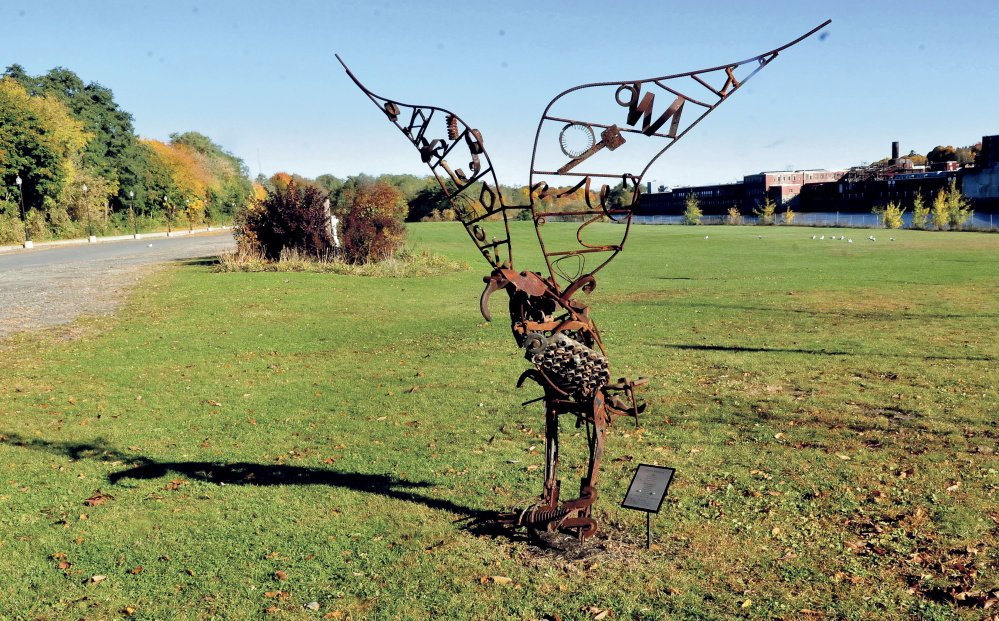 An osprey sculpture and real seagulls dominate Head of Falls area Monday in Waterville. City officials are discussing possibilities for development at the riverside property.