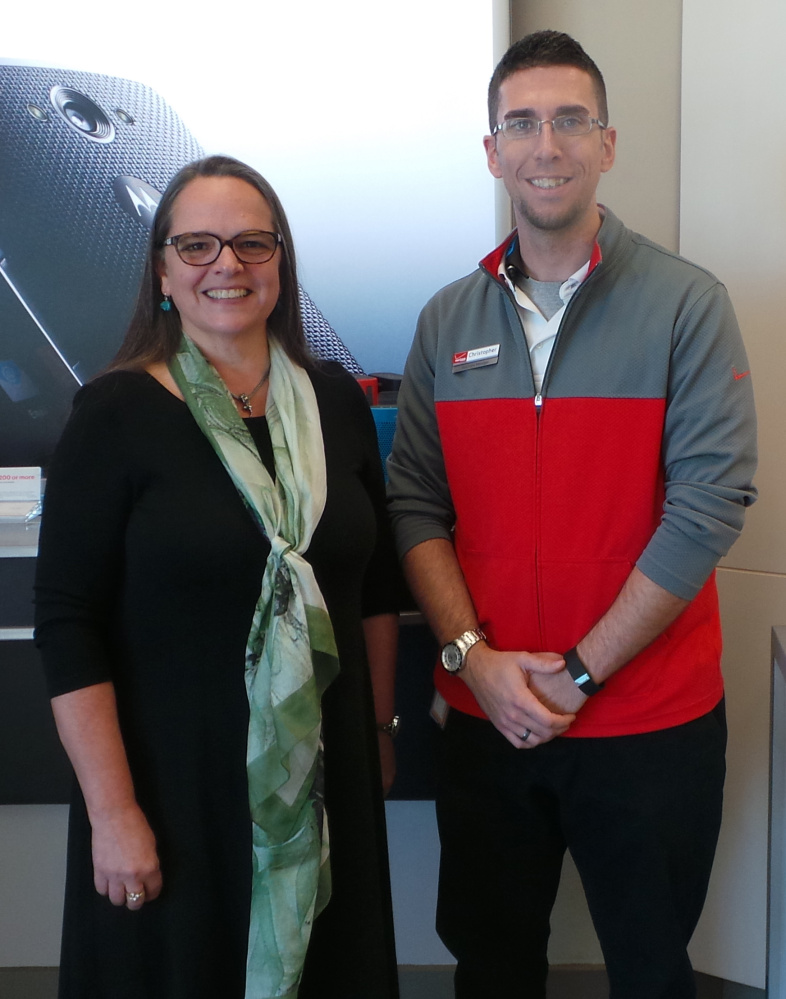 From left, Francine Garland Stark, executive director for Maine Coalition to End Domestic Violence; and Chris Martin, Solutions Manager for Verizon Wireless.
