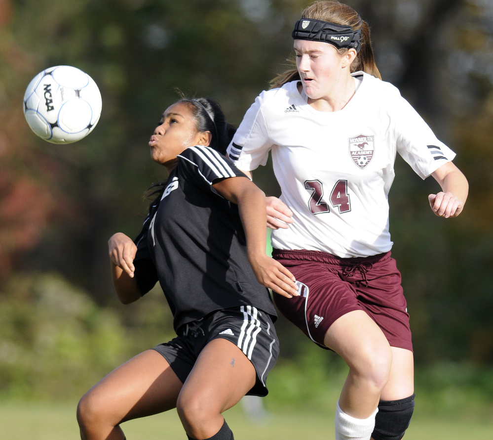 Hall-Dale High School's Thea Sweet, left, attempts to head the ball away from Monmouth Academy's Abby Allen during a Class C South quarterfinal game Tuesday.