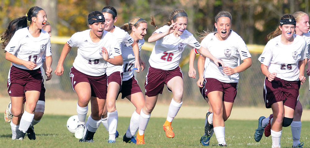 Members of the Monmouth girls soccer team celebrate a goal against Hall-Dale during a Class C South quarterfinal Tuesday.