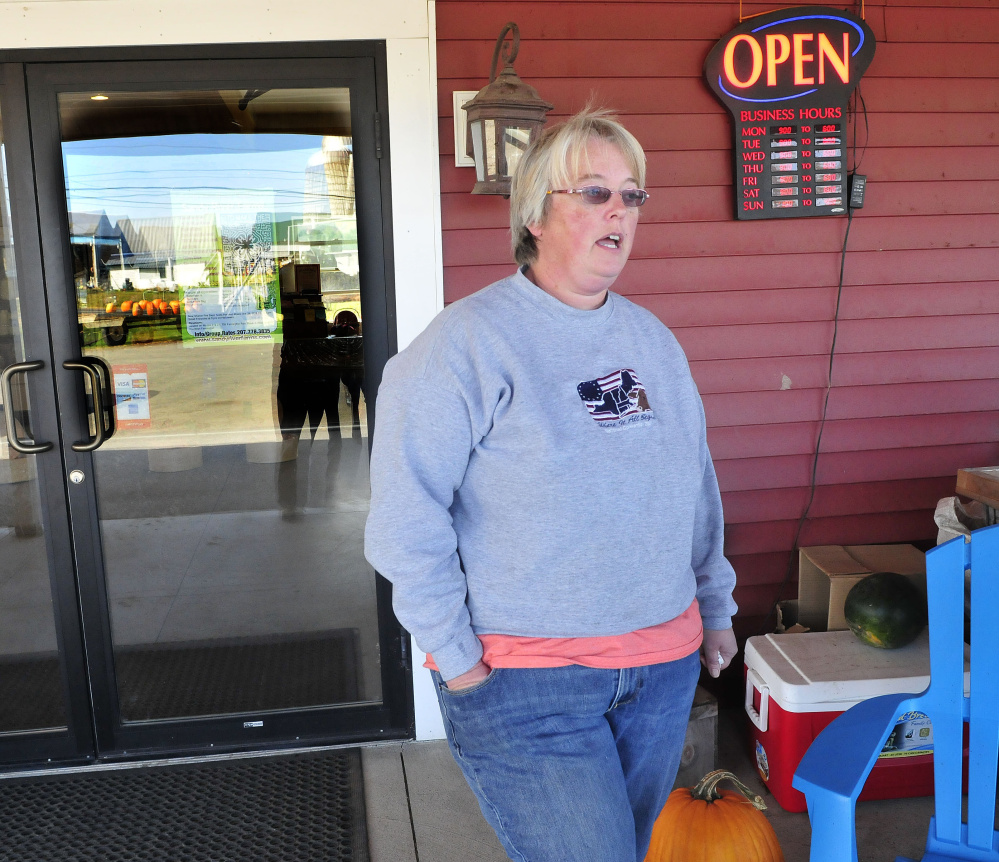Trudy Johnson, part owner of Sandy River Farm Market, on Tuesday discusses the recent burglary at the Farmington store.