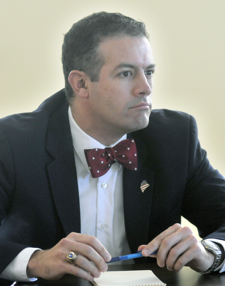 Jonathan LaBonte, director of the LePage administration's Office of Policy and Management, discusses Tuesday a report his office drafted about the Land for Maine's Future program during a board meeting of the group in Augusta.