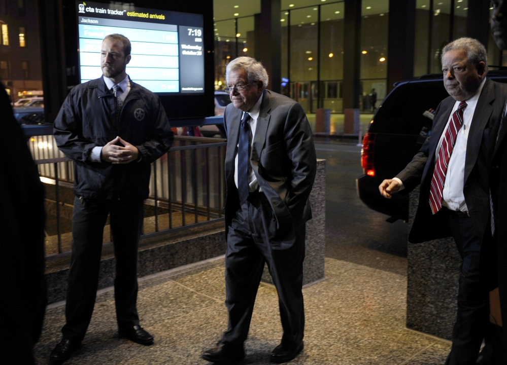 Former House Speaker Dennis Hastert, center, arrives at the federal courthouse Wednesday in Chicago.