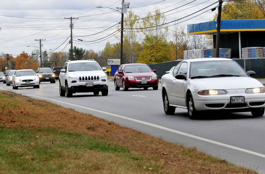 Traffic moves on four-lane Kennedy Memorial Drive in Oakland on Wednesday.  The Maine Department of Transportation is proposing a center turn lane for the road to accommodate increasing development on the road, including a planned Dunkin' Donuts.