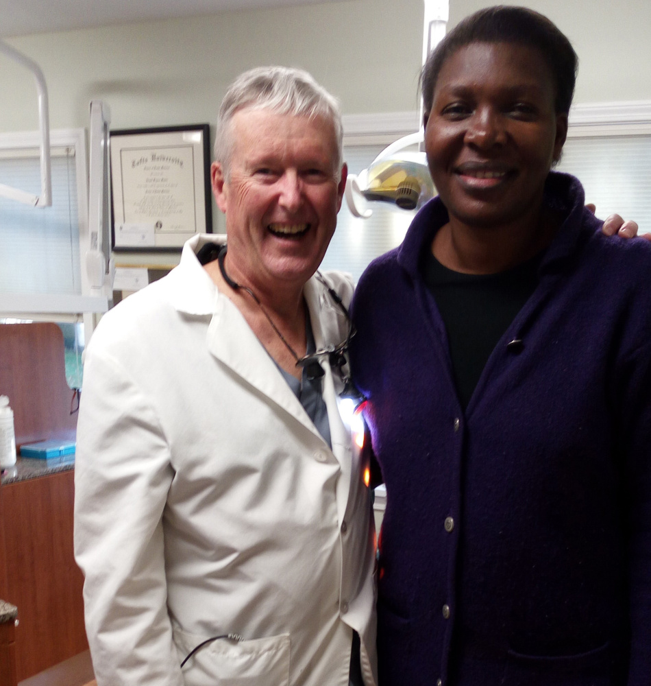 """Pamela Abila, of Kenya, and Dr. George Manter, of Silver Street Dentistry, are all smiles after Manter treated Abila without charge for a painfully infected tooth and provided root canal treatment for a second abcessed tooth last week. Abila is """"one of the next generation caring for the Korando Educational Center,"""" according to Waterville friend Grace Von Tobel, and is also a past president of the Kisumu Kavirondo Rotary Club and spoke to six Rotary clubs in Maine while here."""