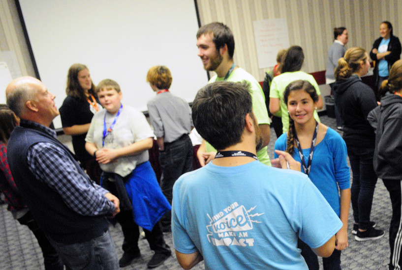 People talk in pairs as part of a session during the The Maine Youth Action Network event on Thursday in the Augusta Civic Center.