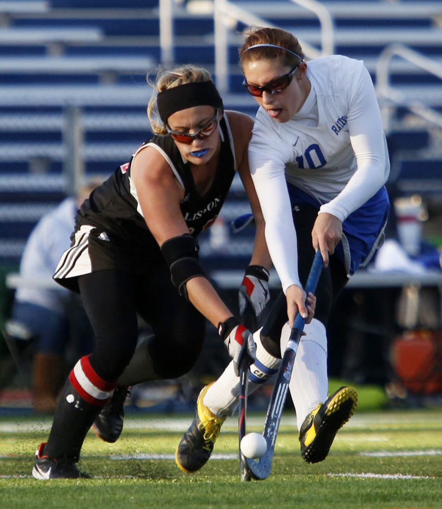 Kaitlyn Phillbrick, left, of Lisbon and Kylee Veilleux of Oak Hill battle for the ball during the second half of the Class C South championship game Tuesday at Fitzpatrick Stadium in Portland.