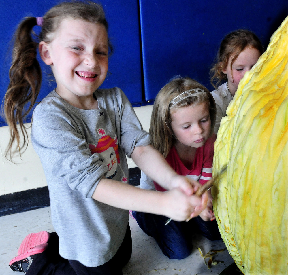 North School Elementary student Savana Ward grimaces as she and Lucy Hitchins carve a pumpkin at the Skowhegan school on Thursday.
