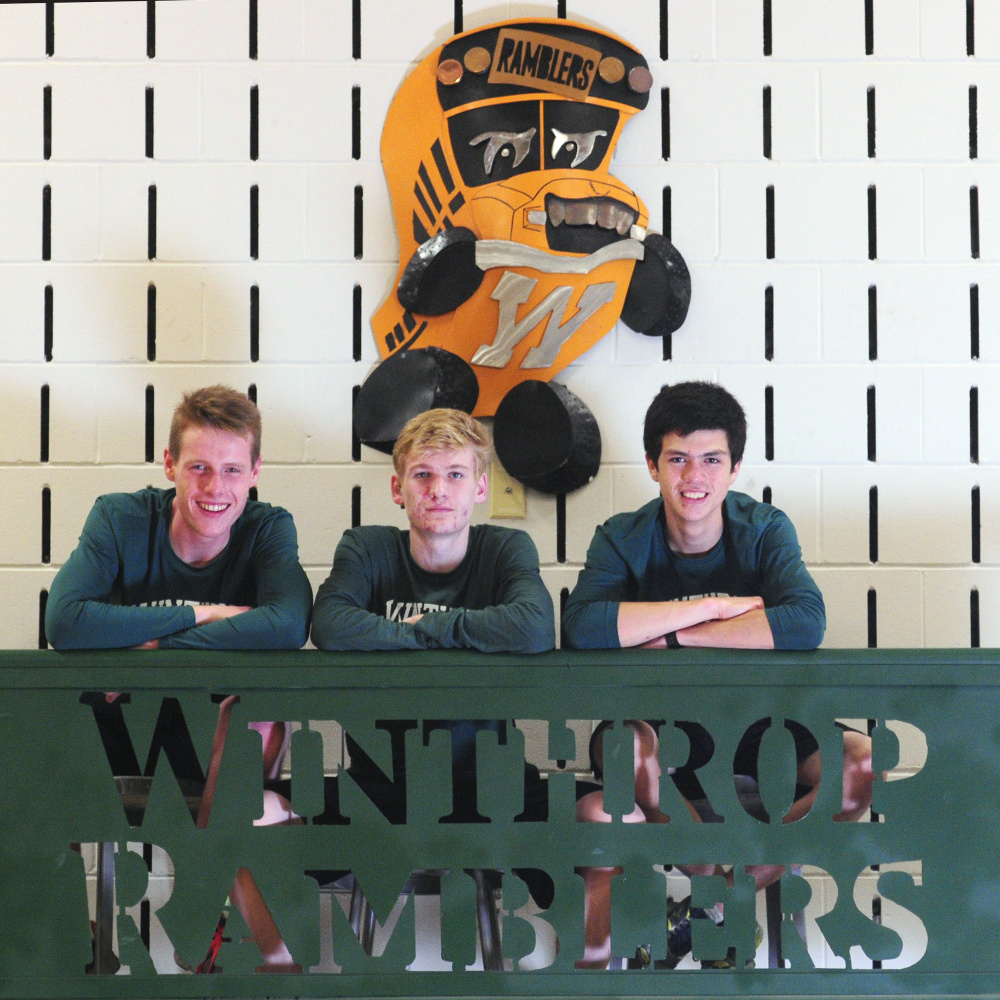 Winthrop's Jacob Hickey, left, Jesse Stevens, center, and William Vance pose for a photo Thursday in Winthrop.