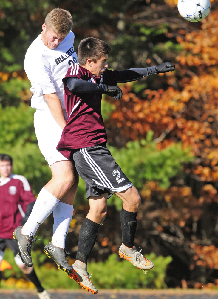 Hall-Dale's Ryan Sinclair, left, and Monmouth's Avery Pomerleau go up for a header during a Class C South semifinal game Wednesday.