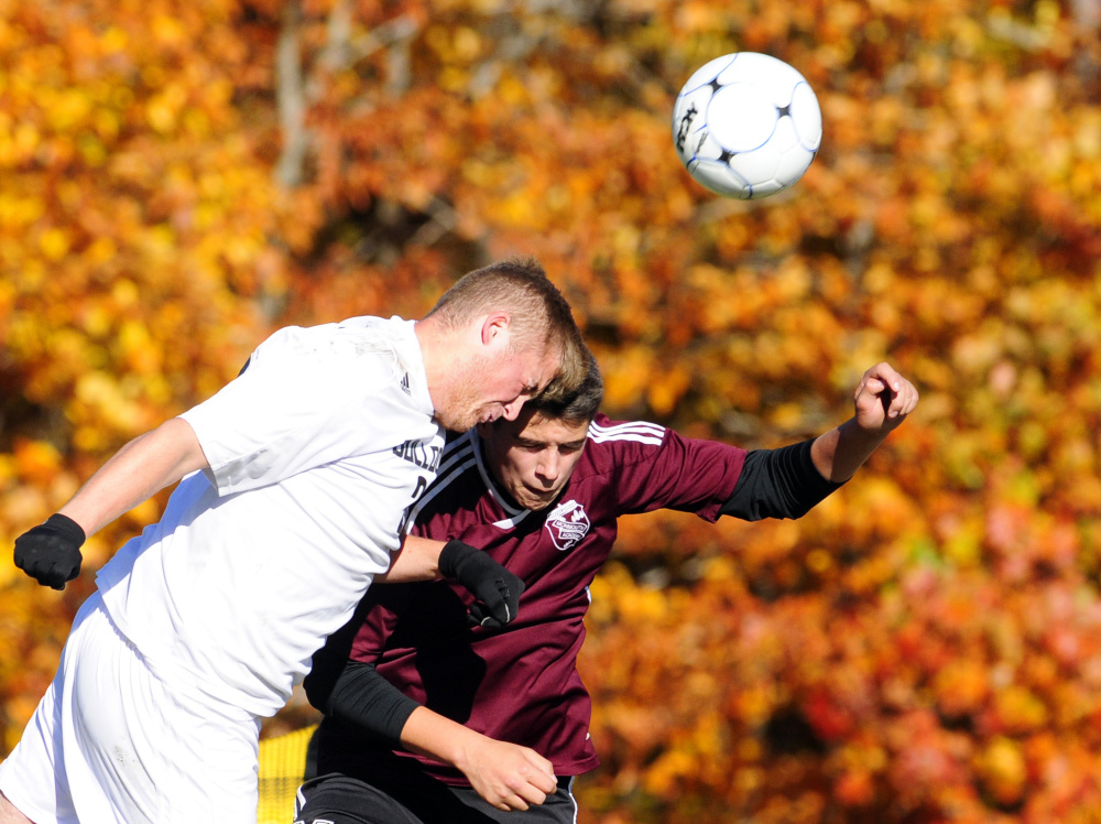 Hall-Dale senior Ryan Sinclair, left, and Monmouth's Travis Hartford go for a header during a Class C South semifinal Friday in Farmingdale. The Mustangs won 2-1 in double overtime.