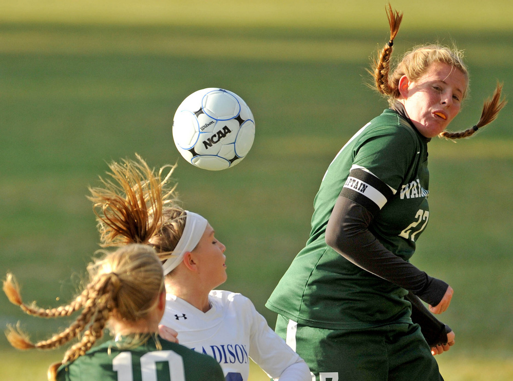 Madison's Madeline Wood, center, battles for the ball with Waynflete's Lydia Giguere (10) and Margie Rowse (27) during a Class C South semifinal game Friday in Madison.