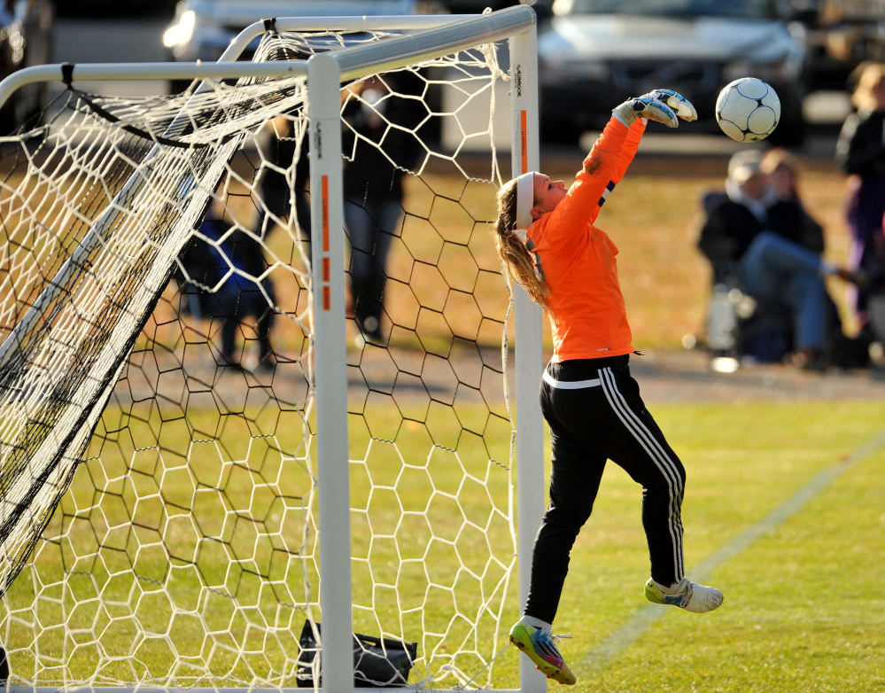 Madison goalie Erin Whalen makes a save against Waynflete during a Class C South semifinal game Friday in Madison.