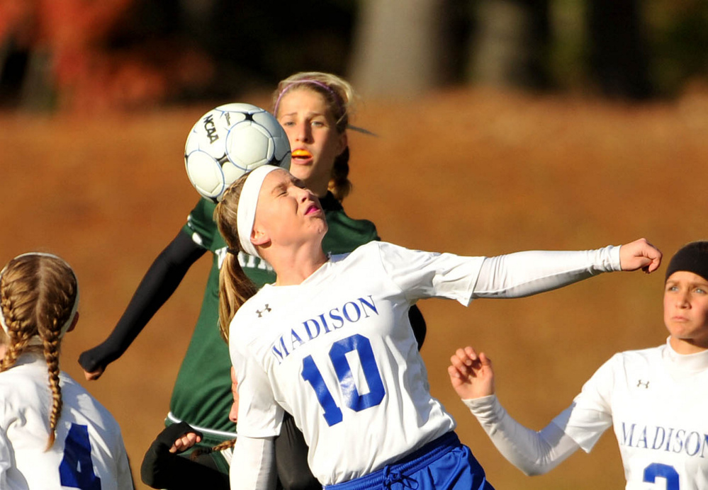 Madison's Madeline Wood (10) gets the header against Waynflete during a Class C South semifinal game Friday in Madison.