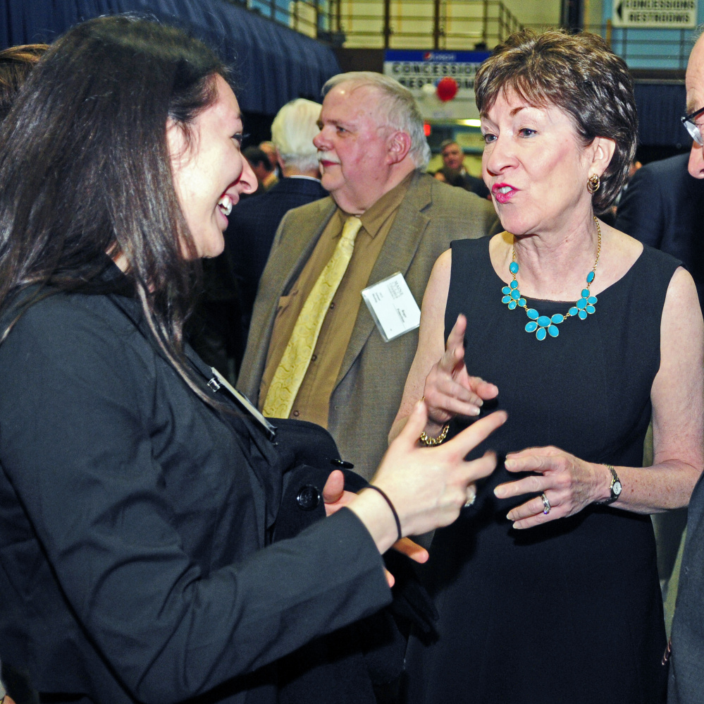 Kristin Bishop, left, chats with U.S. Sen. Susan Collins before the Maine State Chamber of Commerce dinner on Friday at the Augusta Civic Center. Bishop, a Bowdoin College sophomore from Madison, said that she had served as in intern in Collins' Augusta office.