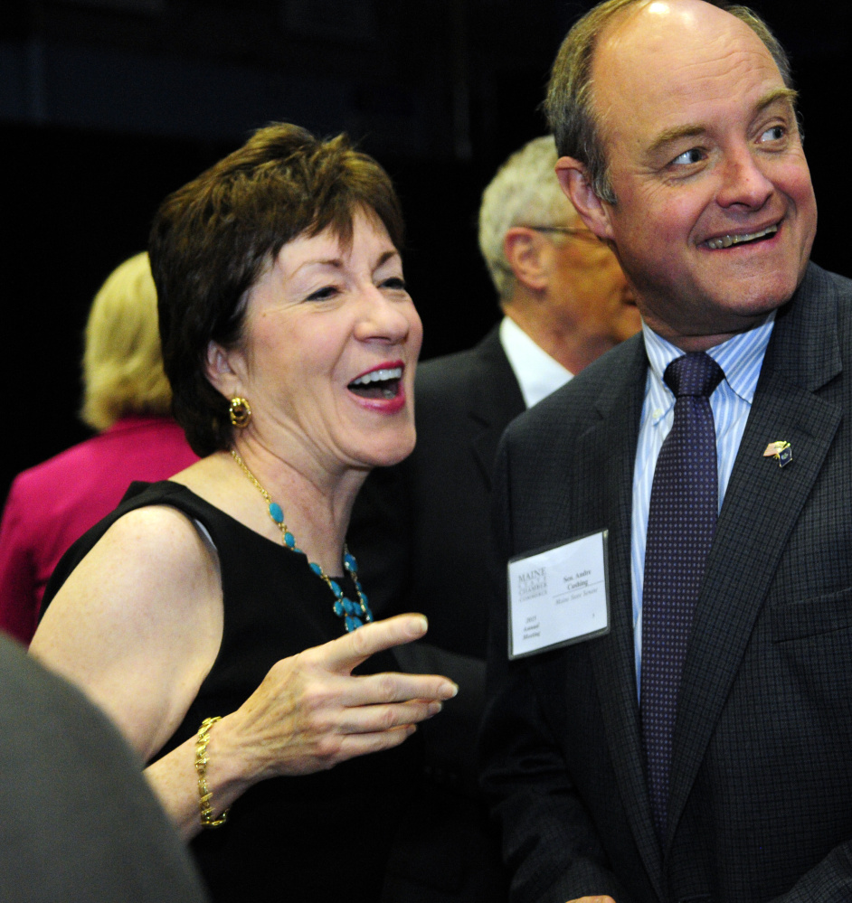 U.S. Sen. Susan Collins, left, chats with state Sen. Andre Cushing, R-Hampden, before the Maine State Chamber of Commerce dinner on Friday at the Augusta Civic Center.