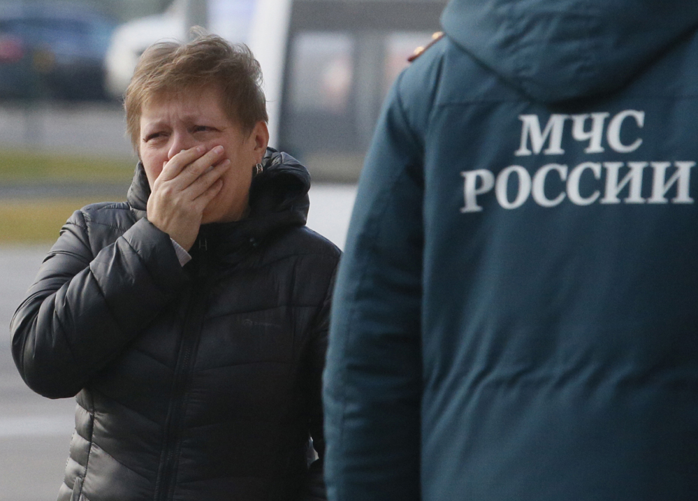 A relative of the victims of a Russian airliner with 217 passengers and seven crew aboard has crashed, reacts at Pulkovo airport in St.Petersburg, Russia, on Saturday.