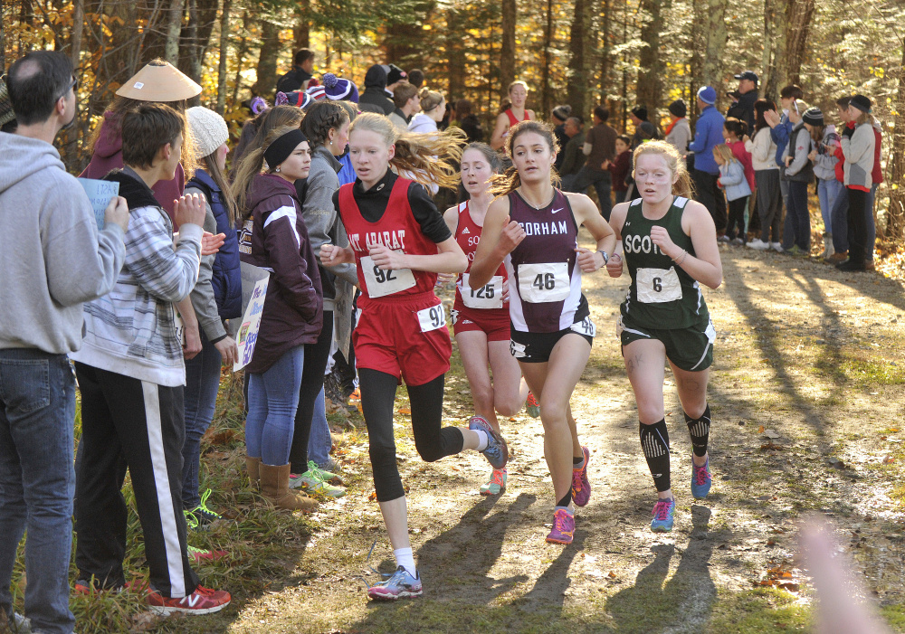 Class A girls runners, from left, Kathrine Leckbee (Mt. Ararat), Serena McKenzie (South Portland), Anna Slager (Gorham), and Bonnie Eagle's Kialeigh Marston lead the pack midway into Saturday's race at Twin Brook Recreation Area in Cumberland.