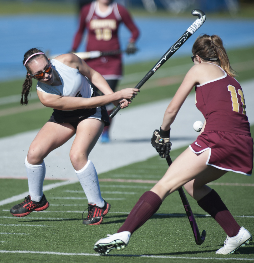 Skowhegan's Maliea Kelso takes a shot on goal as Thornton Academy's Ali Ouelette defends during the Class A field hockey state championship game Saturday in Orono. Skowhegan won 3-1.