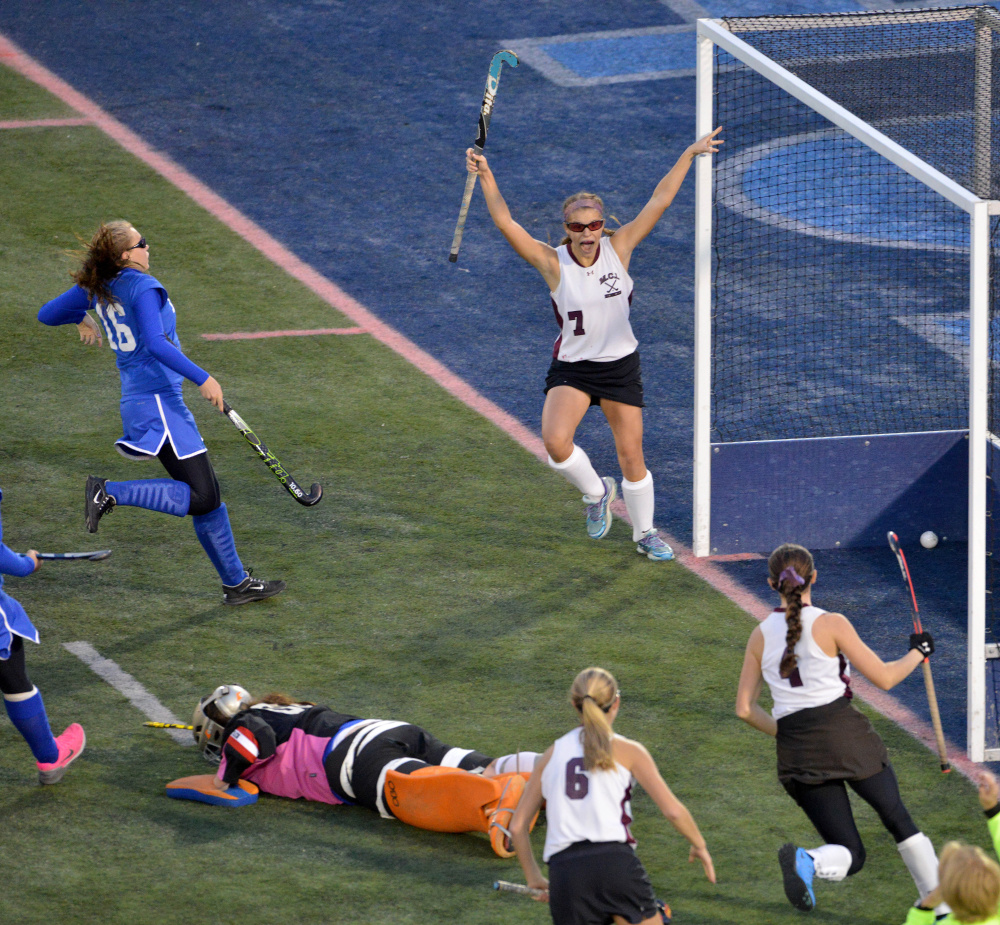 Maine Central Institute's Madison Hartley (1) celebrates a goal by teammate Addie Williams (4) as Oak Hill High School goalie Abby Fuller lies on the turf during the Class C state championship game Saturday at Morse Field at the University of Maine in Orono.
