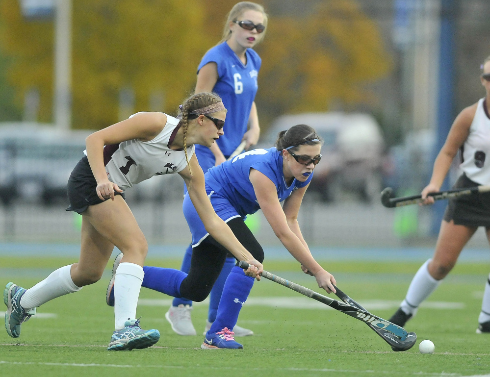 Maine Central Institute's Kali Doiron (7) battles for the ball with Oak Hill High School's Abigail Asselin (14) during the Class C state championship game Saturday at Morse Field at the University of Maine in Orono.
