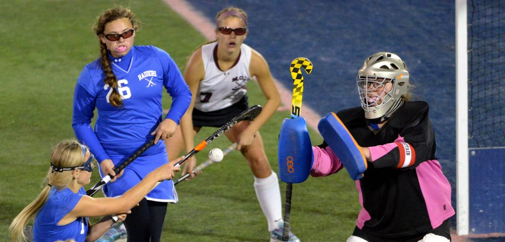 Oak Hill High School's Erika Hannigan (1) tries to stop the ball with her stick as goalie Abby Fuller protects the Oak Hill goal against Maine Central Institute during the Class C state championship game Saturday at Morse Field at the University of Maine in Orono.