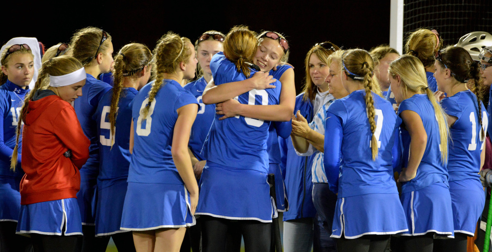 Oak Hill High School consoles one another after losing 3-0 to Maine Central Institute in the Class C state championship game Saturday at Morse Field at University of Maine in Orono.