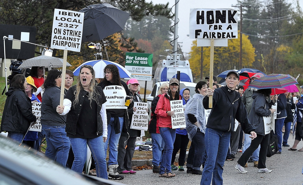 FairPoint workers picket in October 2014 at the company's offices on Davis Farm Road in Portland. A state commissioner has reversed a ruling that FairPoint workers who went on strike were eligible for unemployment benefits. Gordon Chibroski/Staff Photographer